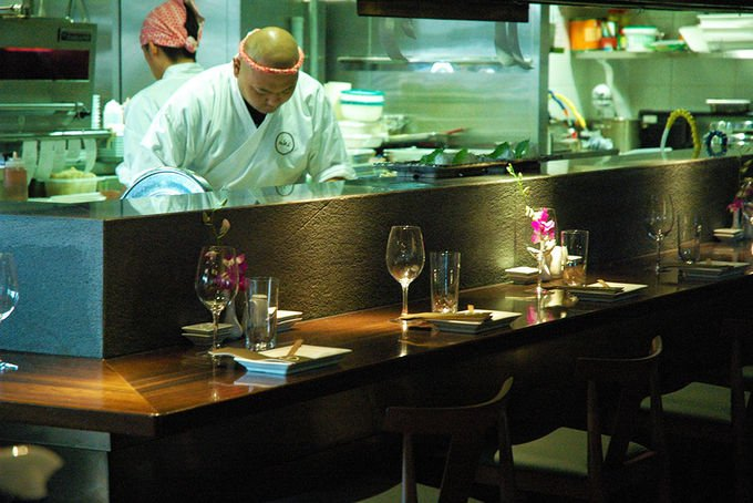 With A Stunning River Backdrop This Lively Restaurant Has Theatrical Line Up Of Chefs In The Open Kitchen Brisbane S Most Extensive Range Sake And